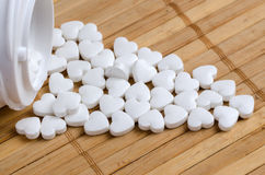 White pills in the form of heart. Close up Royalty Free Stock Photos