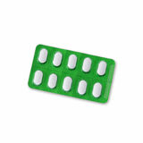 White Pills In Green Blister Royalty Free Stock Images