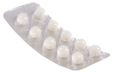 White pills on  isolated Stock Photos