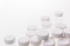 White pills isolated Stock Photography