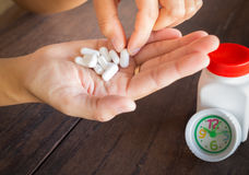 White pills medicine headache on hand Royalty Free Stock Photo