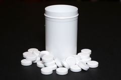 White pills, medicines, on a blach background. White pills, medicines painkiller. Medications on a black background Royalty Free Stock Photo