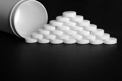 White pills, medicines, on a blach background. White pills, medicines painkiller. Medications on a black background Royalty Free Stock Images