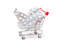 White pills packs in shopping cart Royalty Free Stock Images