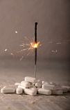 White Pills  with Sparkler for Drug Abuse Concept Stock Photo