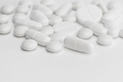 White pills / tablets /medicine - medical background Royalty Free Stock Photo