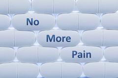 White pills with the words `No More Pain`. Rows of white pills with the words `No More Pain Stock Photo