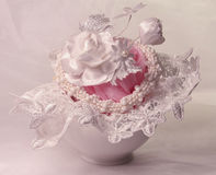 White and pink. White rose from a fabric, lace, a pink transparent fabric and a Royalty Free Stock Photos