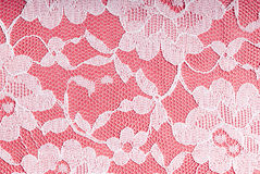 White on pink. White lace on a pink background Stock Photo
