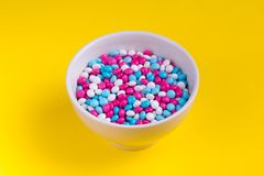 White, Pink, and Blue Candies in Bowl royalty free stock photography