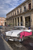 White and pink car in Havana, Cuba. A man cleaning his vintage car in Old Havana, Cuba Stock Image