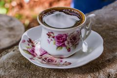 White and Pink Ceramic Floral Teacup With Saucer royalty free stock photography