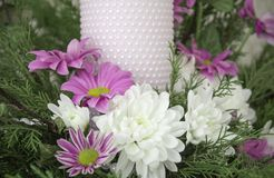 White and pink chrysanthemums with ivy and juniper branches. Festive flower arrangement. Chrysanthemums. And candle Stock Image