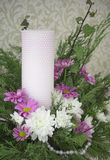 White and pink chrysanthemums with ivy and juniper branches. Festive flower arrangement. Chrysanthemums. And candle Royalty Free Stock Images