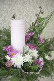 White and pink chrysanthemums with ivy and juniper branches. Festive flower arrangement. Chrysanthemums. And candle Royalty Free Stock Photo