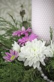 White and pink chrysanthemums with ivy and juniper branches. Festive flower arrangement. Chrysanthemums. And candle Stock Images