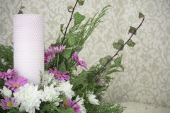 White and pink chrysanthemums with ivy and juniper branches. Festive flower arrangement. Chrysanthemums. And candle Stock Photos