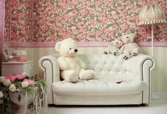 White and pink cozy room with flowers teddy bears white sofa and lamp Royalty Free Stock Photography