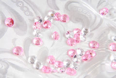 White and pink diamonds. On white fabric Stock Image
