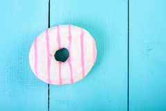 White And Pink Donut On Blue Royalty Free Stock Photo