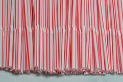 White and pink drink straw. On tile royalty free stock image