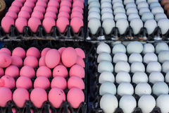 White and pink duck egg displays in black plastic container royalty free stock images