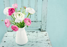 White and pink flowers on light blue chair Royalty Free Stock Image