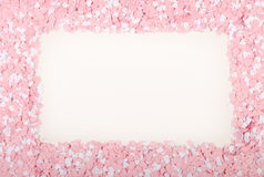 White and Pink Hearts. Scattered around a blank space Royalty Free Stock Photo