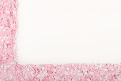 White and Pink Hearts. Scattered around a blank space Stock Photo