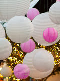 White and pink lightballs hanging on a ceiling Stock Photography