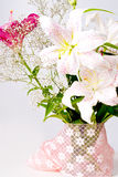 White and pink lily flowers and lace Royalty Free Stock Photography