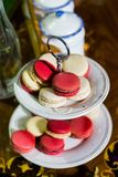 White and pink Macaron on cakestand against container background stock images