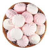 White and pink marshmallow in a wicker bowl on a white Stock Photography