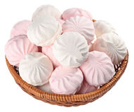 White and pink marshmallow in a wicker bowl on a white Royalty Free Stock Images