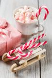 Christmas cup with small marshmallows and candy canes stock photography