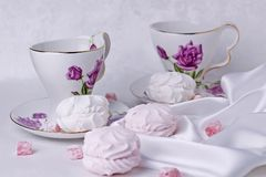 White and pink marshmallows are on the table with beautiful cups for tea. Sweets closeup wooden cocoa christmas beverage food dessert xmas drink holiday cookies royalty free stock photo