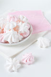 White and pink meringue on a plate Royalty Free Stock Images