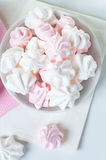 White and pink meringue on a plate Royalty Free Stock Image