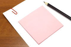 White and pink paper with pencil Stock Images