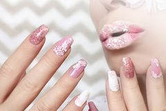 White pink pastel manicure and lip makeup . Stock Photo