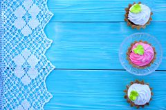 White and pink pastries, lace and blue background royalty free stock photos