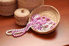 White and pink pearls. With boxes over brown Royalty Free Stock Photos