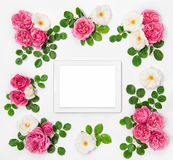 White and pink rose flowers and digital tablet pc Royalty Free Stock Photography