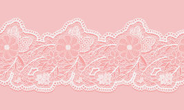 White and pink seamless lacy ribbon on pink background. Floral seamless border for design. Stock Image