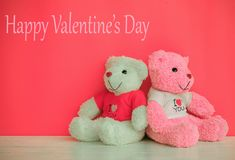 White and pink teddy bear. With red heart on red background. Valentine`s day concept stock image