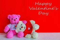 White and pink teddy bear. With red heart on red background. Valentine`s day concept royalty free stock photography