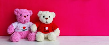 White and pink teddy bear. With red heart on red background. Valentine`s day concept royalty free stock photo