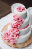 White pink wedding cake with roses stock images
