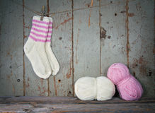 White and pink woolen socks in vintage setting Stock Photos