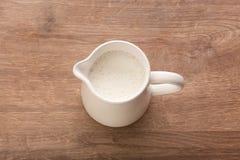 White pitcher with milk Stock Photos